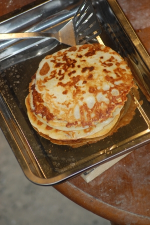 finished: Finished pancakes on kitchen plate Stock Photo