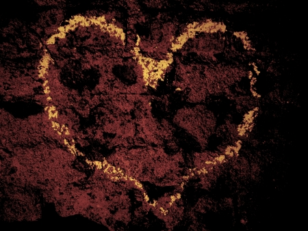 Yellow heart on the dark wall surface Stock Photo - 25025771