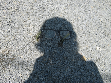 shadow figure on the gravel with glasses Stock Photo - 25028483