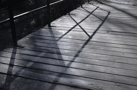 Surface icy boards with shadows from the rail Stock Photo - 26135344
