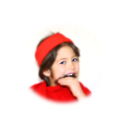 Child in red clothing eating chocolate on white background photo