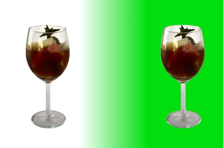 sprig: Dark melon mojito - two kinds of melon, black drink and sprig of mint in a wineglass Stock Photo