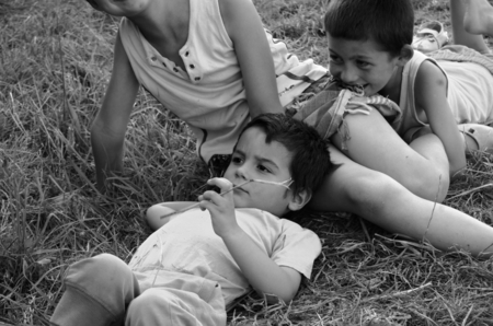 reminiscent: Detail of a group of children on the grass in the assembly reminiscent of Renaissance paintings - retro styled black and white photo Stock Photo