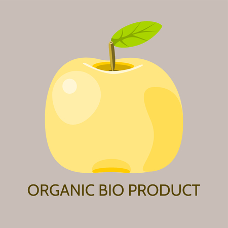 pome: Yellow apple on soft brown background with inscription Organic Bio Product
