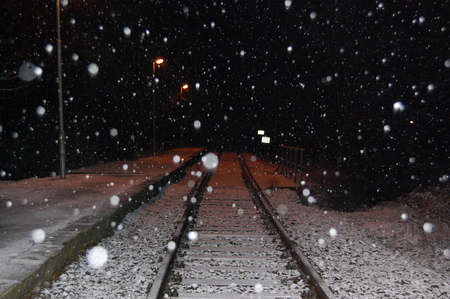 Rails in blizzard in winter in the dark. Rails in blizzard in winter in the dark. A rural road service for passenger rail transport. Bojov, Central Bohemia, Czech Republic.