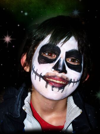 masked boy on the day of the dead tilting her head to the left with a dreamy expression Stock Photo