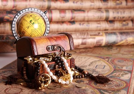 jewellery box: Antique chest with jewelry, globe on vintage map