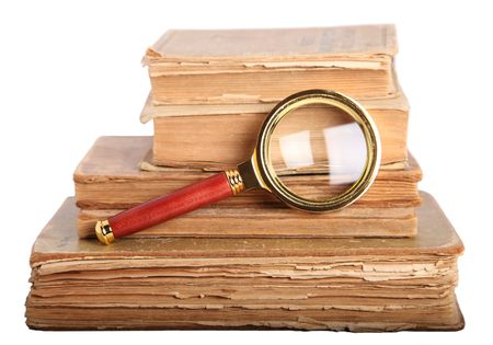 Stack of books and magnifying glass isolated on white background Stock Photo - 6242956