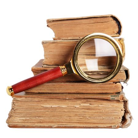 Stack of books and magnifying glass isolated on white background Stock Photo - 6242976