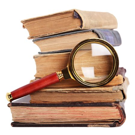 Stack of books and magnifying glass isolated on white background Stock Photo - 6242966