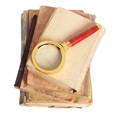 Stack of books and magnifying glass isolated on white background Stock Photo - 6242975