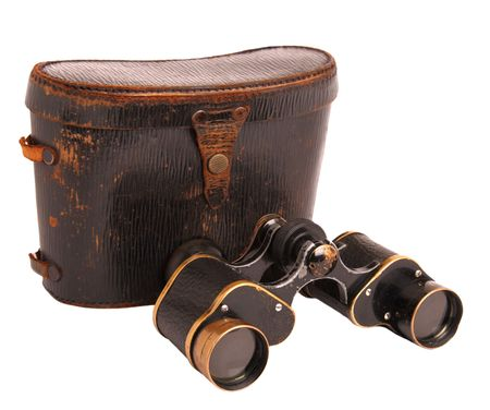 Old binoculars and leather case isolated on white photo