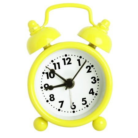 Yellow alarm clock with bells isolated on white  photo