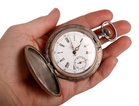 Hand shows antique pocket watch, isolated on white photo