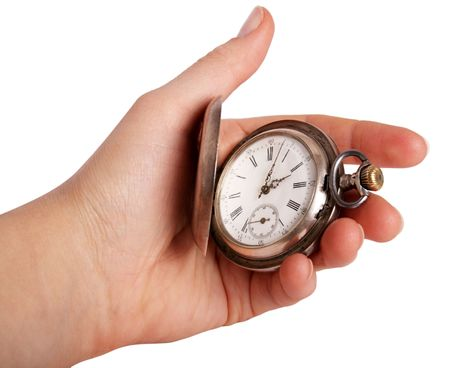 Silver pocket watch in hand isolated on white photo