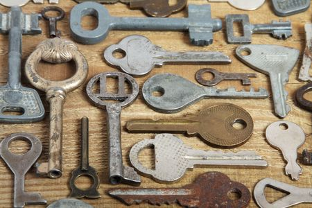 Old different keys on wooden background photo