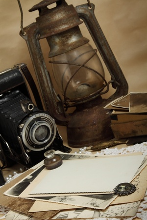 kerosene lamp: Retro camera, kerosene lamp and old photos on the knitted cloth