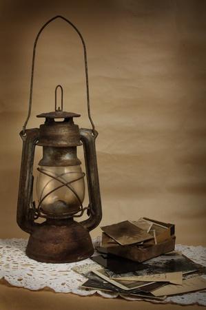 Old kerosene lamp and photos on the cloth Stock Photo - 10015685
