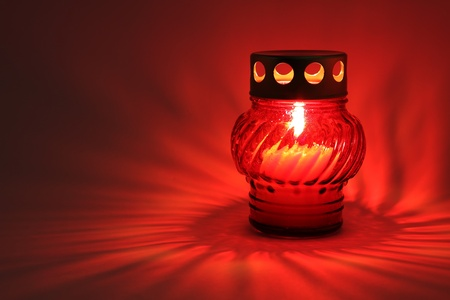 funeral background: Memory lantern with burning candle in the dark