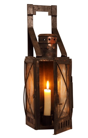 Old lamp with burning candle, isolated on white background photo