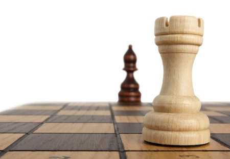 chessmen: Rook opposite the bishop on a chess board Stock Photo
