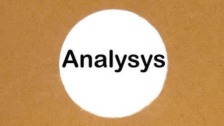 the inscription analysis on a white background in a round hole made of cardboard Standard-Bild