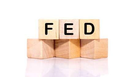 FED, the concept of the Federal Reserve System, a cubic wooden block with the alphabet building the word Fed
