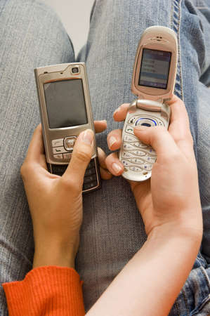 Friends exchanging contact numbers
