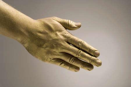 Golden hand offering a handshake