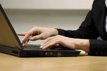 A pair of hands using laptop