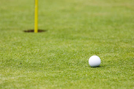 Golf ball with hole by the side Stock Photo - 3193027