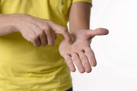 Young man showing sign language Stock Photo - 3193031