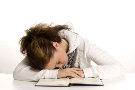 revision book: Teenage girl sleeping on the book LANG_EVOIMAGES