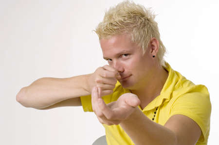 nonverbal communication: Young man showing sign language