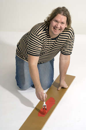 Man painting a wood Stock Photo - 3193079
