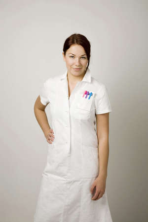 Woman in lab coat posing for the camera Stock Photo - 3193098