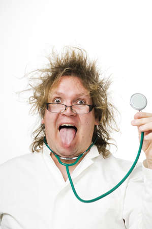 messy: Doctor with messy hair sticking out his tongue while holding up stethoscope