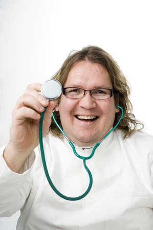 Doctor smiling while using stethoscope Stock Photo - 3193118