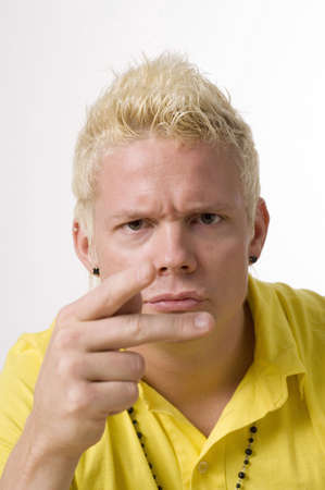 Young man showing sign language Stock Photo - 3193127