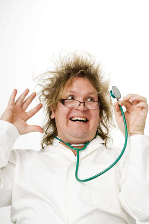 Crazy doctor smiling while looking at stethoscope Stock Photo - 3193137