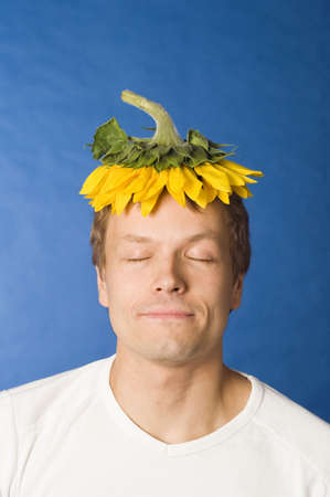 humor: Man with sunflower on his head