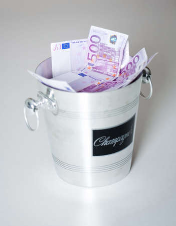 Money inside a champagne ice box Stock Photo - 3193195