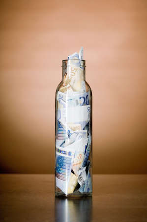 Banknotes in a jar Stock Photo - 3193196