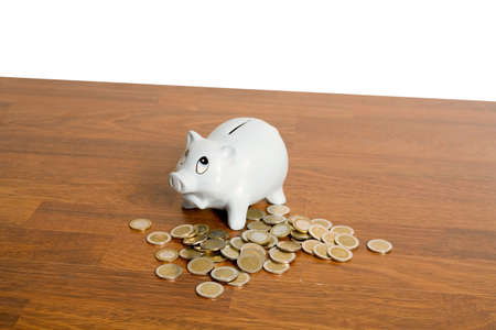 Piggy bank and some Euro coins Stock Photo - 3193200