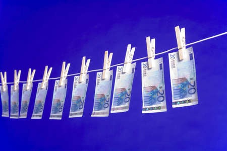 money laundering: Banknotes hanging on a clothesline LANG_EVOIMAGES