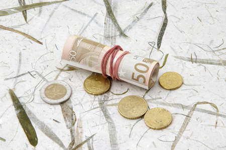 Coins and roll of banknotes Stock Photo - 3193223