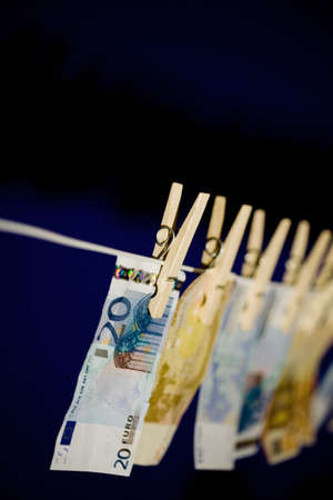 Banknotes hanging on a clothesline Stock Photo - 3193229