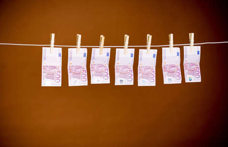Money hanging on a clothesline Stock Photo - 3193237