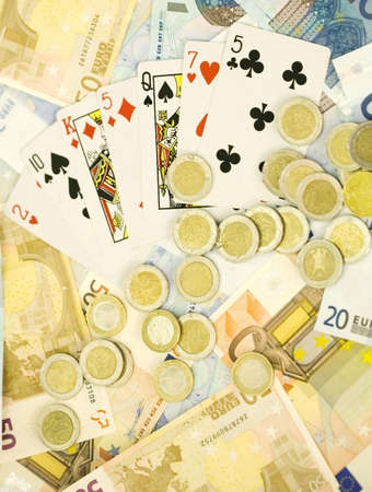 Euro banknotes, coins and playing cards Stock Photo - 3193240