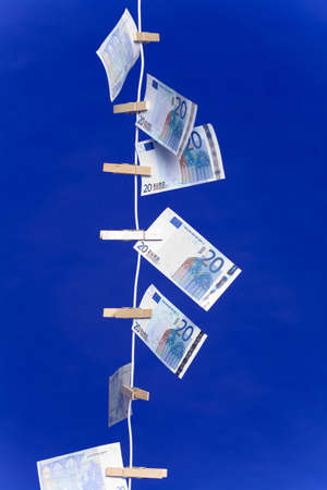 Banknotes hanging on a clothesline, vertical Stock Photo - 3193246